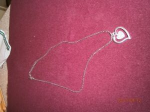 Four brand new necklaces