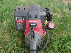 Troy-Bilt 4-cycle gas line trimmer. Runs, needs some work.