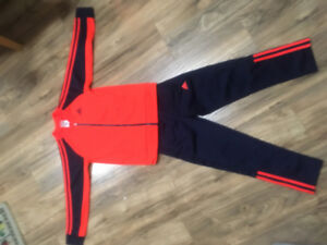 FOR SALE:  nike track suit (boys or girls) Size 7 smal