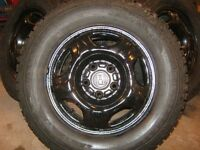 4 Firestone Winterforce studded tires 205-70-15