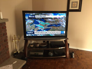 """60"""" Olevia Flat Screen LCD TV with Stand and wall Mount, $400"""