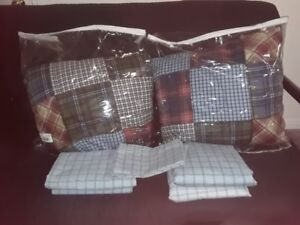 Two Twin Comforter and 2 sheet sets in excellent condition