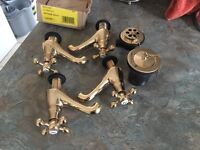 2 sets of brass taps