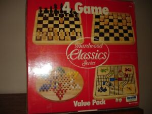 Three solid wooden board games
