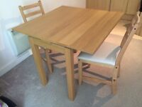 Extendable dining table ikea (bjursta) and two chairs (Lerhamn)