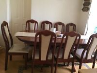 Clean, Wood polished Table with 8 Chairs.