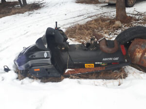 Three parts sleds with boxes of parts