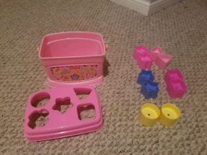 Baby blocks and pink container