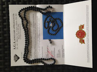 Long strand of Black Cultured Pearls - appraised at $1230