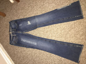 Bebe  size 27 little distressed jeans .  Low rise