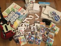Massive Wii bundle incl 25 games, Wii Fit Board, Band Hero drums + guitar and boxes