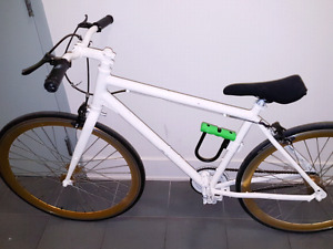 Norco painted white with golden tires. With a 60$ lock.