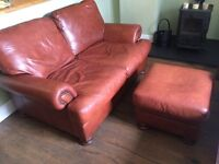 Brown leather two seater sofa and pouffe