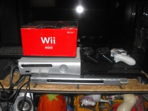 *Silver Xbox360 60 gig with av hookup 1 controller & 4 games*