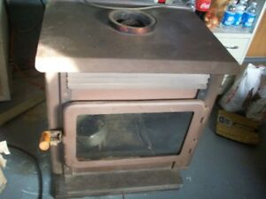 Wood burning stove with blower