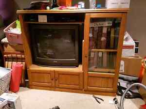 Solid wood entertainment center and Toshiba tube TV.