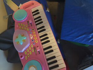 Kids keyboard with microphone and little tikes basketball net.