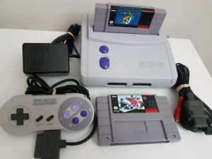 Super Nintendo Jr , complete with hook ups + 2 game cartridges