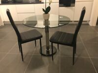 Round glass table with 2 chairs