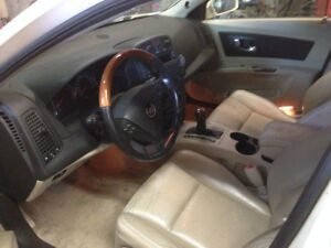 nice pearl white Cadillac parting out or sell complete