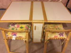 Fold-able Dining Table with 4  folding chairs and cushions