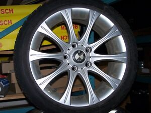 SET OF 4 USED BLIZZAK WS70 WINTER TIRES ON BMW RIMS