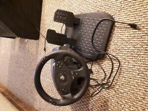 Playstation racing wheel with pedals.