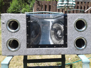 "2 10"" MA Audio 600w subs in ported bandpass."