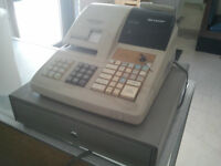 cash register, photocopier, file cabinet ,  storage cubburd