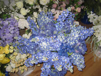 Beautiful blue artificial flowers and organza sashes
