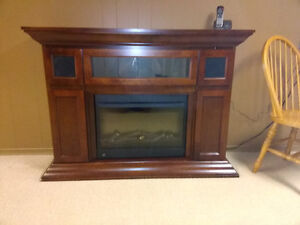 Freestanding electric fireplace and hearth