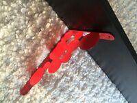 Dark brown shelf with red brackets