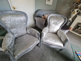 Silver crushed velvet armchairs.