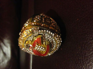 Championship rings and handbags for sale.