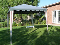 Used 8x8 Foot Portable Plastic & Canvas Gazebo Canopy