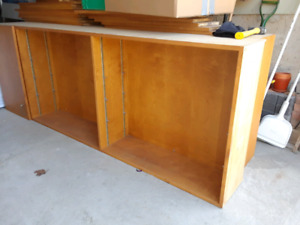 2 wooden shelving units