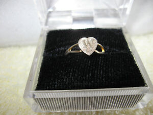 "A CHILD'S ADJUSTABLE FAUX-GOLD SIGNET RING ..""W""..."