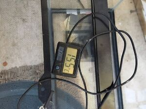 Small reptile tank with heating pad and digital thermometer