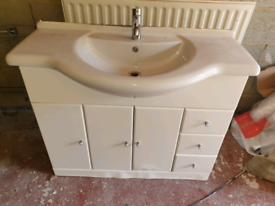 Large basin with drawers and tap