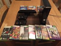 XBOX 360 with Kinect. It comes with two controllers plus many games. Only been used very rarely.