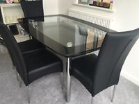 Black & clear glass dining table with 4 free chairs