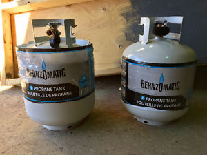 Two 20 lb Propane Tanks - One is full