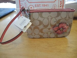 Coach wristlet floral applique