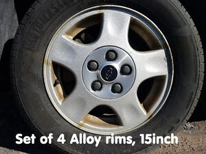 4 Tires on Alloy Rims, 215/60R15 - 2 New Tires, 2 older ones.