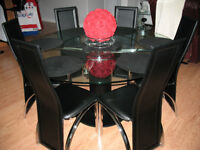 70 inch Round Dining Table plus a sideboard