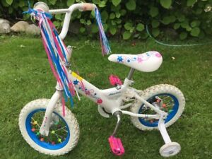 Decked out girls bike with training wheels