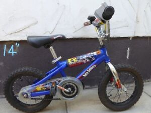 """Hot wheel 14"""" Kids mountain bike in excellent condition like new"""