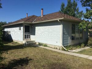 Pet friendly house for rent in woodbine Calgary sw.