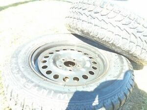 4 winter rims and tires Kitchener / Waterloo Kitchener Area image 1