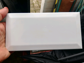 About 70 white bevelled tiles (kitchen, bathroom)